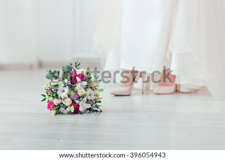 wedding shoes and wedding bouquet of white roses - stock photo