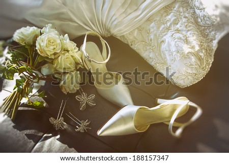 Wedding shoes with bouquet of white roses  on chair - stock photo