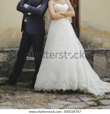 Wedding summer couple together posing against brick wall. - stock photo