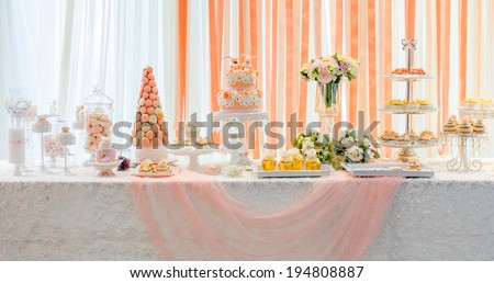 wedding sweet dessert Fondant Cake and  Macarons  gift table in  - stock photo