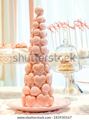 wedding sweet dessert Fondant Cake and  Macarons  gift table in house - stock photo