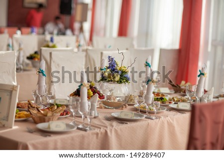 Wedding table bridal dinner at royal restaurant cafe at marriage day France. wedding hall. Wedding reception area ready for dinner and party. Table set for an event party or wedding reception. food - stock photo