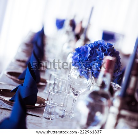 Wedding table. Close-up of folded napkin and empty glasses   - stock photo