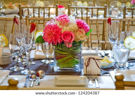 Wedding table decoration and floral centerpiece - stock photo