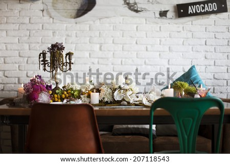 Wedding table decoration for bride and groom in interior, with chairs.  - stock photo