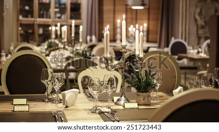 Wedding table decoration with candles - stock photo