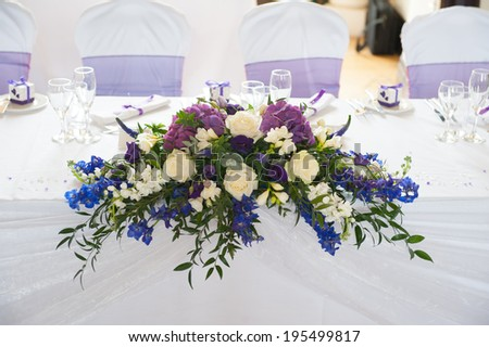 wedding table flowers in white and purple - stock photo