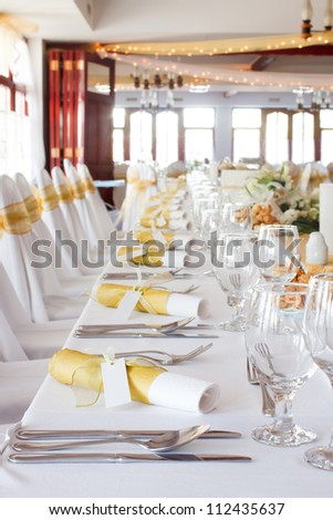 wedding table set for fine dining or another catered event - stock photo