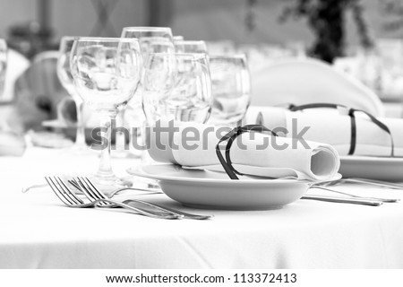 wedding table set for fine dining or another catered event - black and white - stock photo