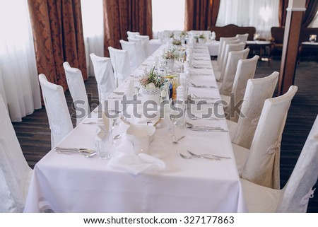 Wedding table setting white plate and fork glasses - stock photo