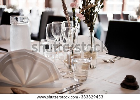 Wedding table setting with elegant white decoration - stock photo