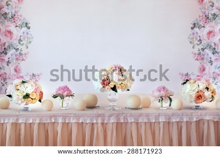 Wedding table setting with flowers - stock photo