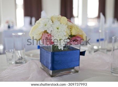 Wedding table with bouquet of gerbera flowers  - stock photo