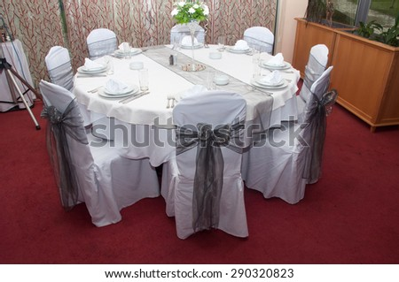 Wedding table with plates and spoons and forks. - stock photo