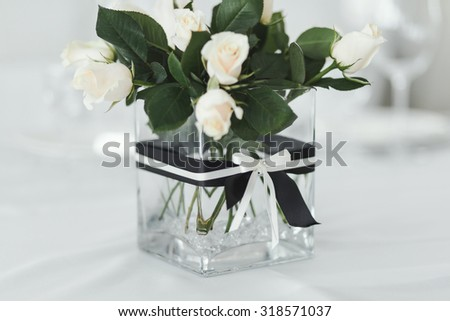 Wedding table with white roses in vase.  - stock photo