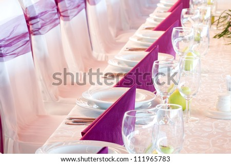 wedding tables set for fine dining or another catered event - stock photo