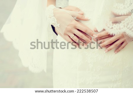 wedding theme, holding hands newlyweds with golden rings - stock photo