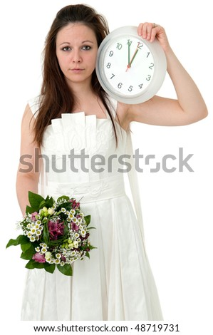 wedding time - bride holding clock - stock photo
