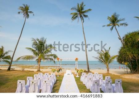 wedding venue, wedding setup,  arch,  decorated with flowers, beach wedding setup - stock photo