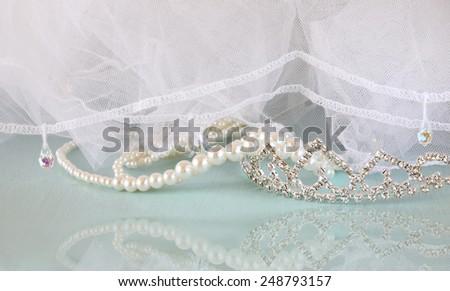 Wedding vintage crown of bride, pearls and veil. wedding concept  - stock photo