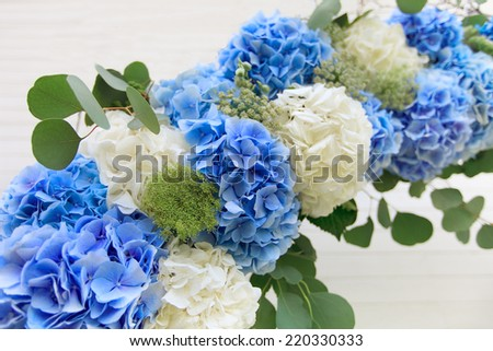 Wedding white and blue arch of flowers on background - stock photo
