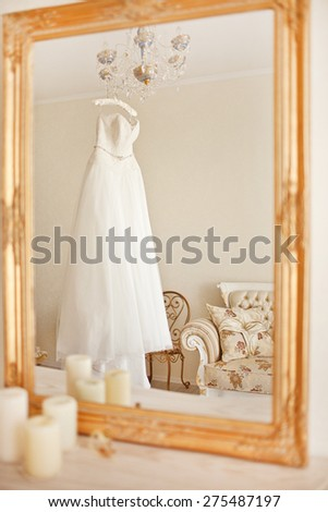 Wedding white gorgeous dress in vintage interior - stock photo