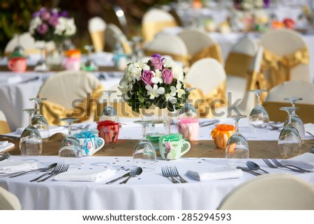 Wedding white reception place ready for guests. Elegant banquet tables prepared for a conference or a party - stock photo