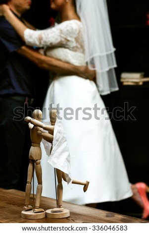 Wedding. Wooden people staying and hugging, wedding couple  at bokeh. People Love concept - stock photo