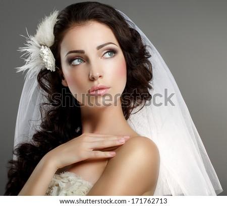 Wedding. Young Gentle Quiet Bride in Classic White Veil Looking Away - stock photo