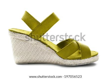 Wedge heeled yellow sandal on white background - stock photo