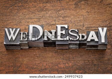 Wednesday word in mixed vintage metal type printing blocks over grunge wood - stock photo