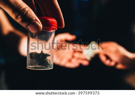 Weed dealing , paying a drug dealer  - stock photo