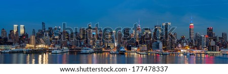 WEEHAWKEN, NJ, UNITED STATES - FEBRUARY 17, 2014: New York midtown panorama at dusk. The Empire State Building displays the colors of the American flag, in honor of the Presidents' Day (60Mpx) - stock photo