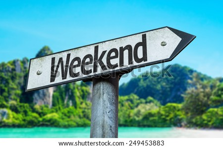 Weekend sign with a beach on background - stock photo