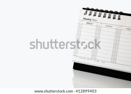 weekly planner on white background - stock photo