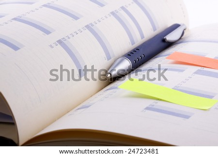 Weekly planner with pen - stock photo