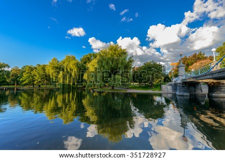 Weeping willow trees and a pond in the Boston Public Garden - stock photo