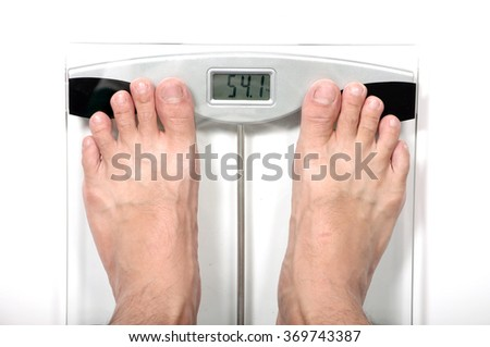 Weighing on Digital Weight Scale - stock photo