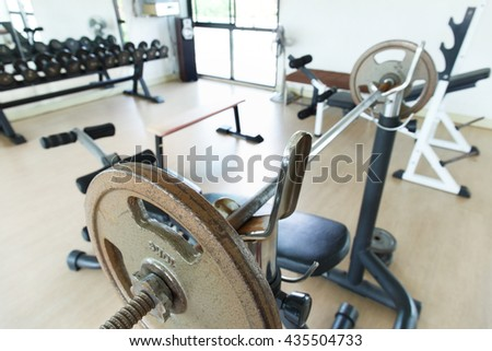 Weight lifting in fitness gym.Indoor sport club. - stock photo