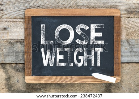 Weight lose sign. Weight lose sign on chalkboard - stock photo