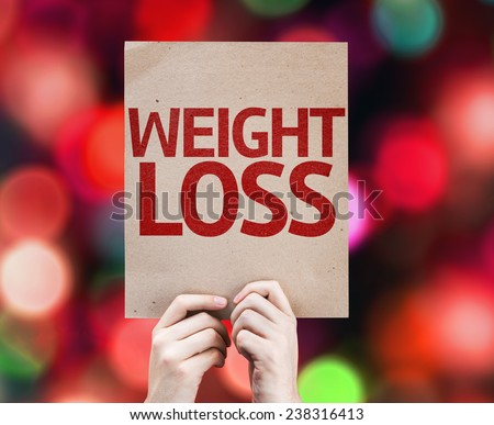 Weight Loss card with colorful background with defocused lights - stock photo