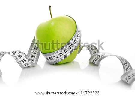 weight loss concept. Apple and measuring tape on white background. Diet. - stock photo
