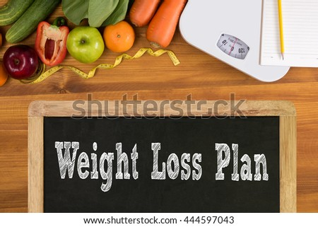 weight loss plan Fitness and weight loss concept, dumbbells, white scale, fruit and tape measure on a wooden table, top view, free copy space - stock photo