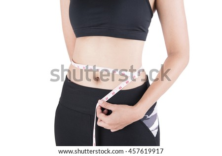 Weight loss woman standing hand measuring waist isolated on white background. Photography in studio. - stock photo