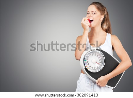 Weight Scale, Exercising, Dieting. - stock photo