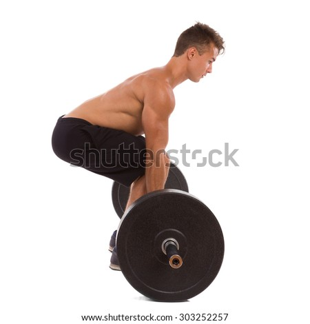 Weightlifting, side view. Full length studio shot isolated on white. - stock photo