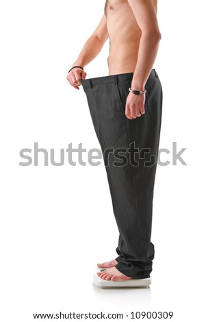 Weightloss – Man standing on a measuring scale - stock photo