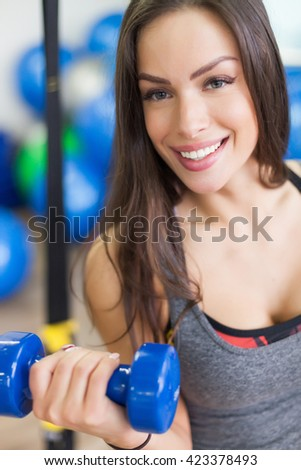 Weights before dates. Beutifol woman in the gym - stock photo