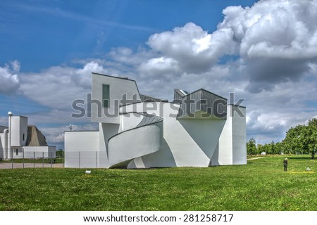 WEIL AM RHEIN, GERMANY - MAY 17: Vitra Design Museum designed by Frank Gehry on May 17, 2015. The Vitra Design Museum is located outside the city of Basel in Switzerland, but in Germany. - stock photo