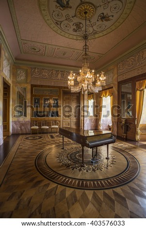 WEIMAR, GERMANY - APRIL 17, 2014: Famous Ceder room with a piano in the Stadtschloss (city castle) of Weimar, Thuringia, Germany - stock photo